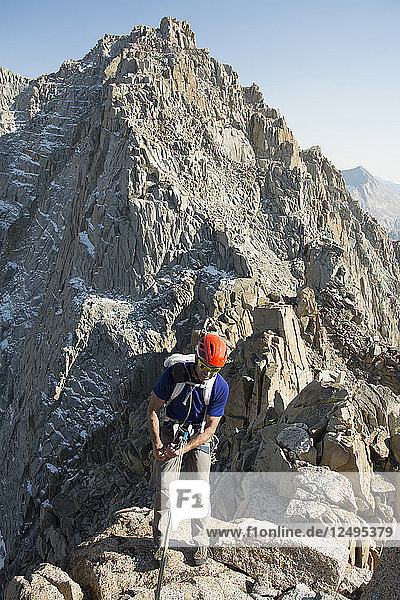 A man rappelling a granite ridge on the Evolution Traverse  John Muir Wilderness  Kings Canyon National Park  Bishop  California.