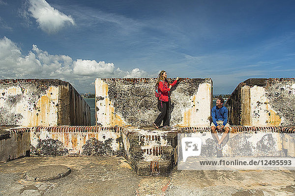 Couple In The Historic Fort On The Edge Of The Atlantic Ocean From Old San Juan  Puerto Rico