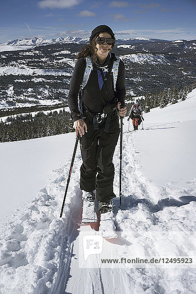 A Snowboarder Sandra Hillen Touring Up Near Vail Pass In The Winter