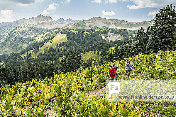 Mother and daughter hiking on Colorado Trail near Trout Lake and¬ÝKennebac¬ÝPass in San Juan National Forest