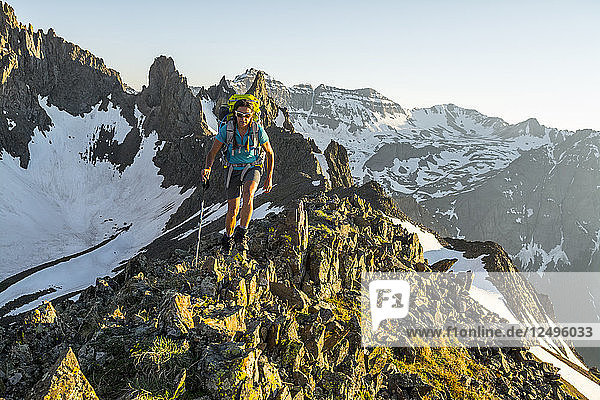 A Female Hiker Hiking On Blaine Peak Below Mount Sneffels In Colorado