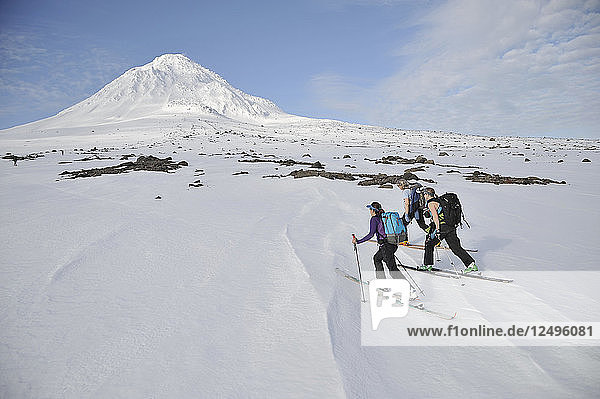 Group Of Skier Ascend Mount Saint Augustine Volcano  Alaska  Usa