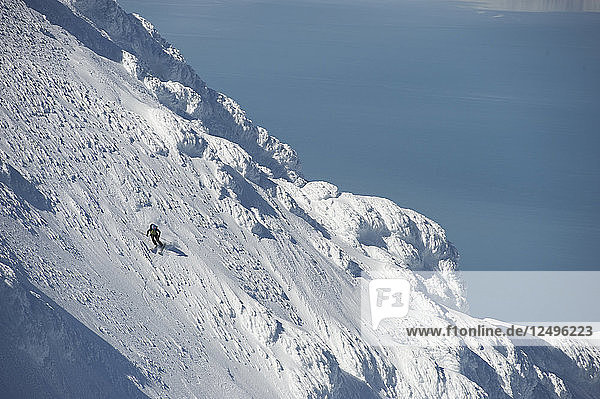 Skier Skiing At Mount Augustine  Alaska  Usa