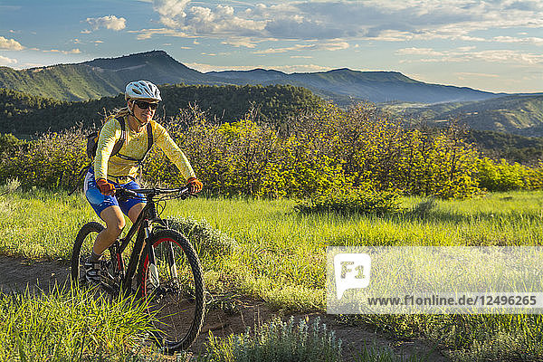 A woman mountain biking on the Horse Gulch Trail System  Durango  Colorado