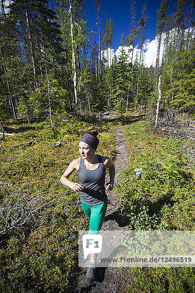 Trail running in Bowron Lake Provincial Park.