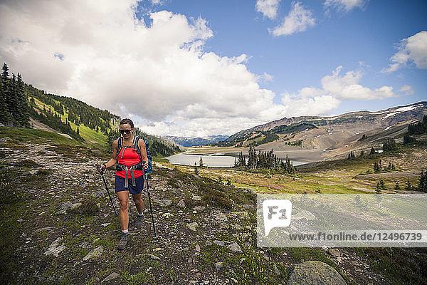 A young woman hiking near Helm Lake in Garibaldi Provincial Park  British Columbia  Canada.