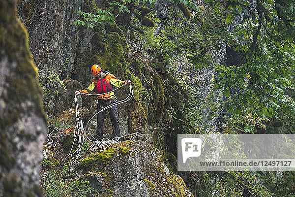 Explorer Evan Howard Manages Rope At A Rappel Station