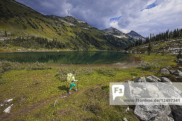 Backpacker Hiking Along The Shores Of Marriott Lake In Canada