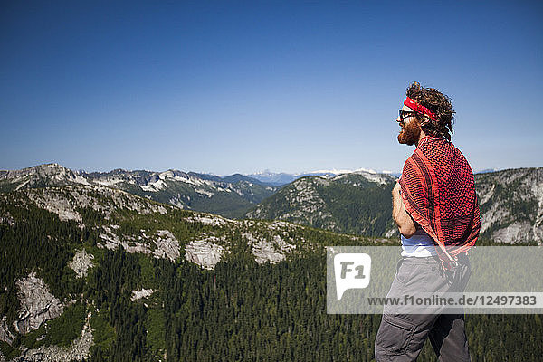 Evan Howard  a climber and explorer  looks toward the mountains while climbing in British Columbia  Canada.