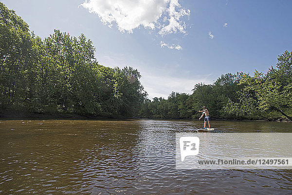 Man Paddleboarding On The Saco River In Maine