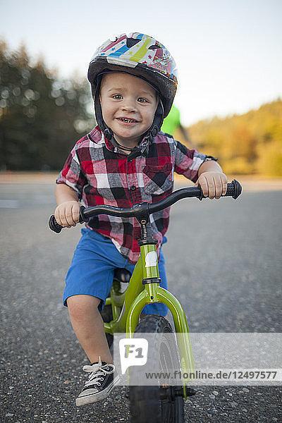Portrait Of A Young Boy Riding A Bike