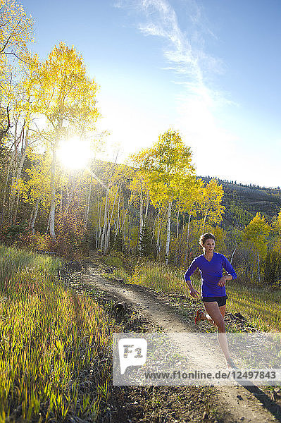 Woman running on a trail in Park City  Utah