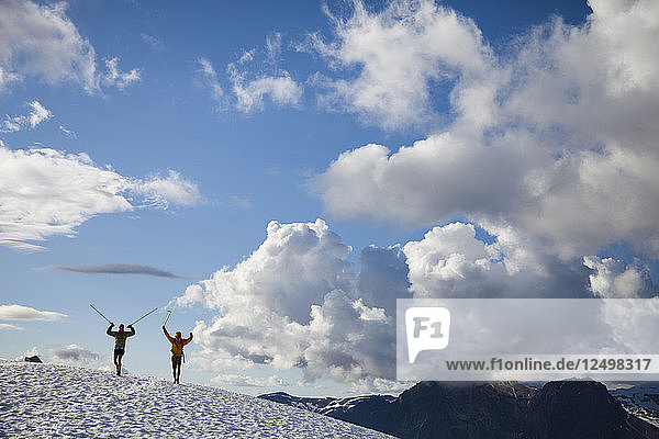Two Backpackers Hiking In Snow