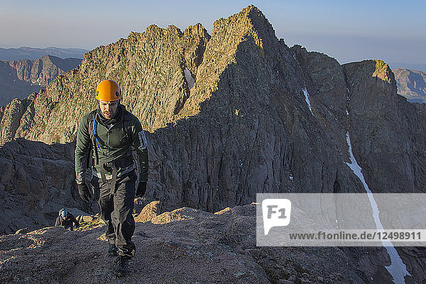 Two Man Hiking On The Summit Of North Eolus