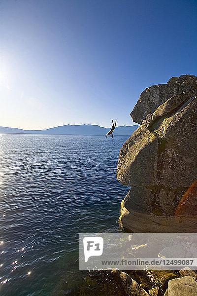 Man Jumping In Lake Tahoe During Sunrise