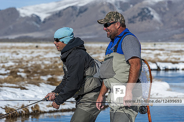Two Fishermen Fly Fishing On The Upper Owens River