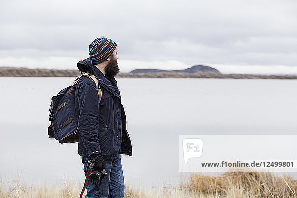 Hipster photographer with camera enjoying nature outdoors in Oregon.