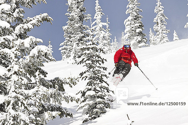 Male Skier Jumping On Snowy Landscape At Whitefish Mountain Resort In Whitefish  Montana