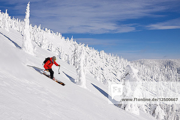 Male Skier Skiing On Snowy Landscape In Whitefish  Montana  Usa