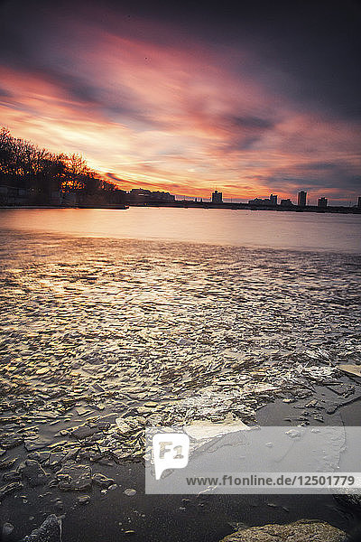 Ice Floats Along The Frozen Charles River At Sunset In Boston  Massachusetts