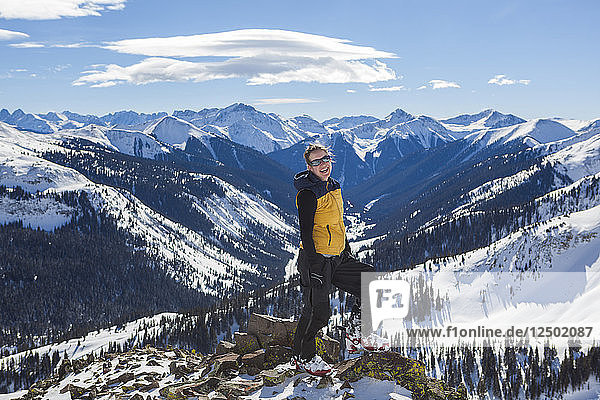 Myl?®ne Jacquemart laughs with joy at the base of Trico Peak's east ridge above Red Mountain Pass  San Juan National Forest  Colorado.