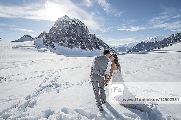 Bride and groom get married on a glacier in Denali National Park.