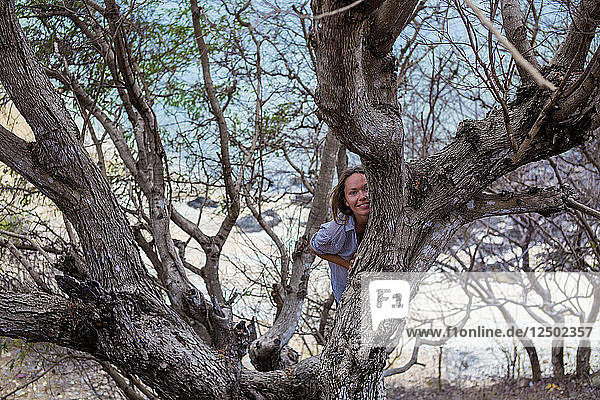 Yong Woman on the tree.West Sumbawa.Indonesia.