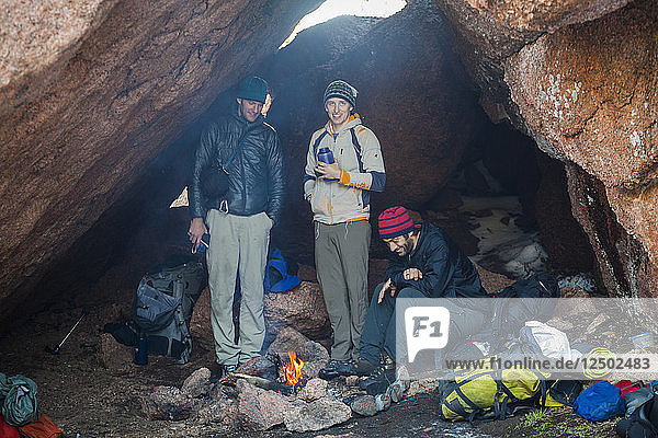 Backpackers camp in a cave in McMurdy Park  Lost Creek Wilderness  Colorado.