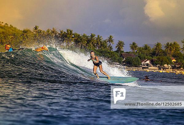 Surfer girl on a wave.