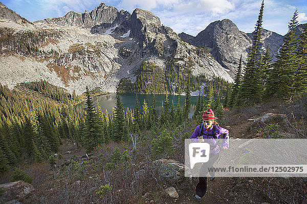 A Woman Trail Running In Valhalla Provincial Park  British Columbia  Canada