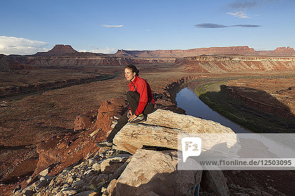 A woman enjoys the views from below Turks Head  Canyonlands National Park  Utah.