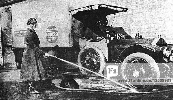 Volunteer English woman driver washing down her ambulance  Cambridge  World War I  1915. Artist: Unknown