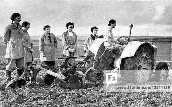 British girls of the Womens Land Army learning to plough with a tractor  World War II  1939-1945. Artist: Unknown