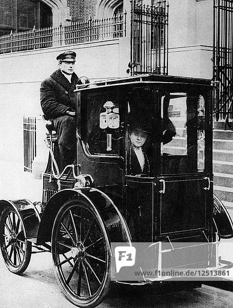 Woman passenger in a 1910 taxi cab  New York  USA  (c1910?). Artist: Unknown