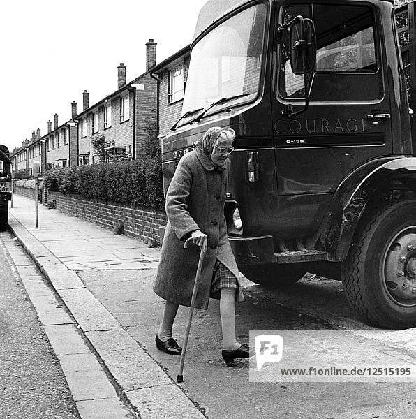 Old woman and truck on a London street  1977. Artist: Henry Grant