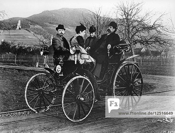 Karl Benz with his wife Bertha in a Benz-Viktoria  1893. Artist: Unknown