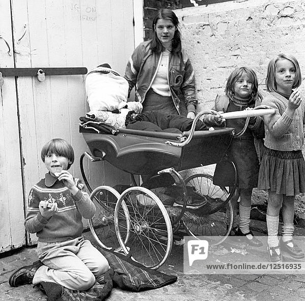 Children playing Penny for the Guy in a London yard  Oct 1978. Artist: Henry Grant