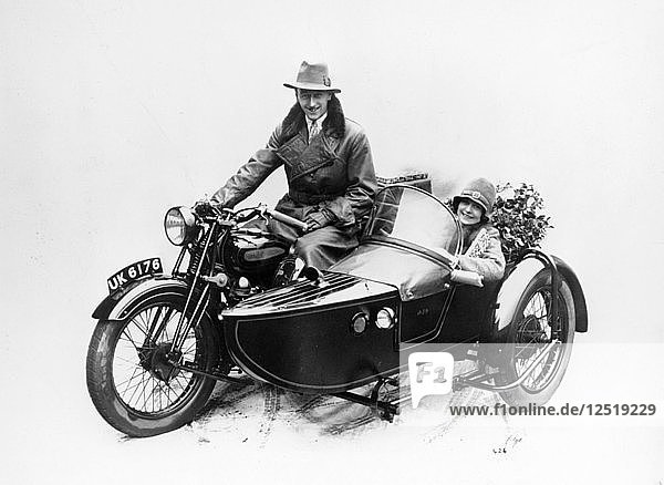 Man riding an AJS motorbike with a woman in the sidecar  1939. Artist: Unknown
