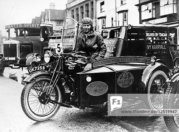 Woman riding a 1929 500cc AJS motorbike  (c1929?). Artist: Unknown