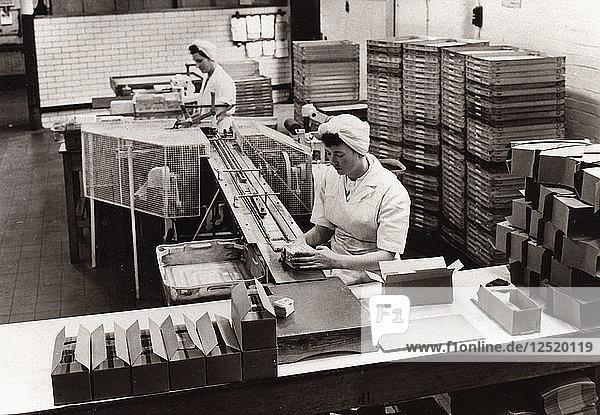Girls packing Kit Kat  Rowntree factory  York  Yorkshire  1956. Artist: Unknown