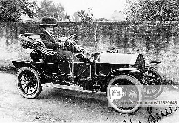 A woman at the wheel of an 8hp Humber  1909. Artist: Unknown