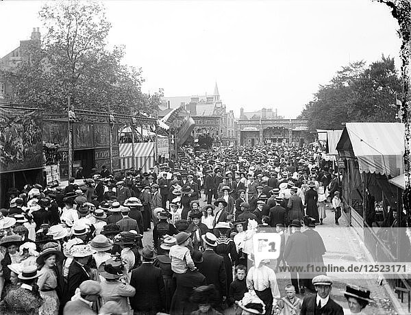 Crowded street lined with stalls during St Giles Fair,  Oxford,  Oxfordshire,  c1860-c1922. Artist: Henry Taunt