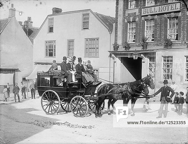 Horse drawn bus with passengers outside the Bull Hotel  Burford High Street  Oxon  c1860-c1922. Artist: Henry Taunt