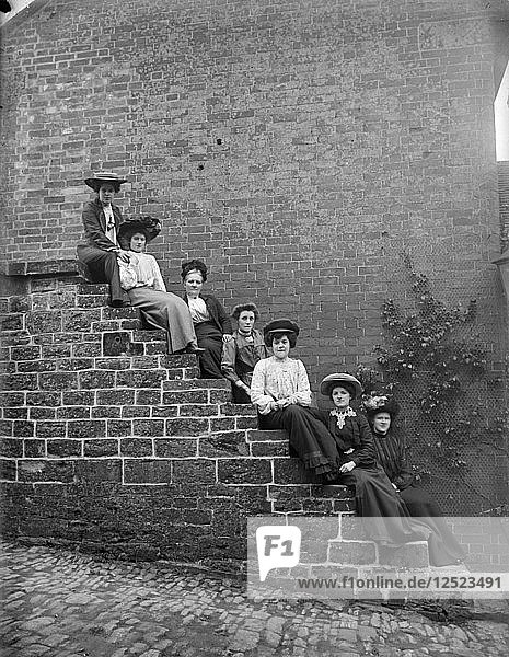 Women on steps  Hellidon  Northamptonshire  c1896-c1920. Artist: Alfred Newton & Sons