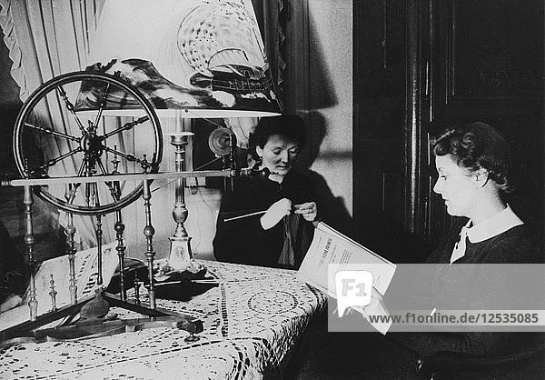 Two women at home  France  1939. Artist: Unknown