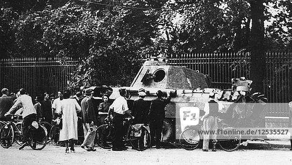 Bystanders examining an abandoned tank on the Rue de Medicis  liberation of Paris  August 1944. Artist: Unknown