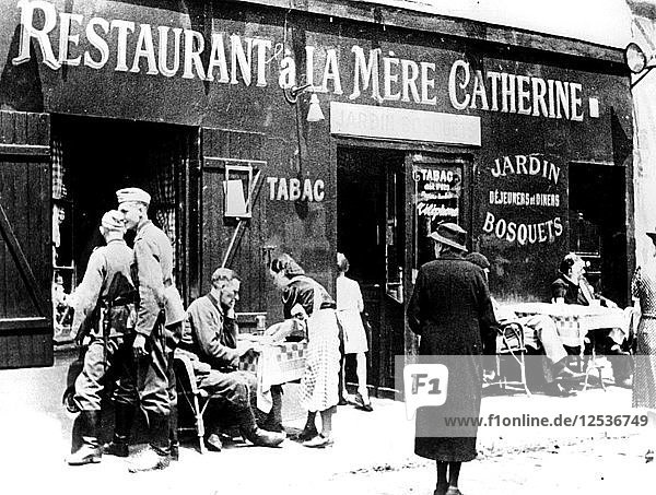 German soldiers at a restaurant  occupied Paris  June 1940. Artist: Unknown