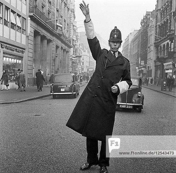 An informal portrait of a traffic policeman standing in the road  City of London  c1946-c1959. Artist: John Gay