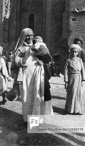 Muslim woman and child  Iraq  1917-1919. Artist: Unknown
