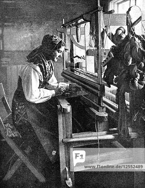 Woman using a loom  Sweden  1936. Artist: Unknown